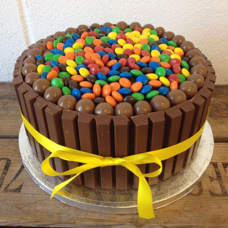 A chocolate lovers paradise! Chocolate ganache cake covered with kitkats, maltesers and M&Ms