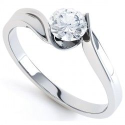 Tension Set Twist Solitaire Engagement Ring. A tension set round brilliant cut diamond engagement ring with the most minimalist setting.