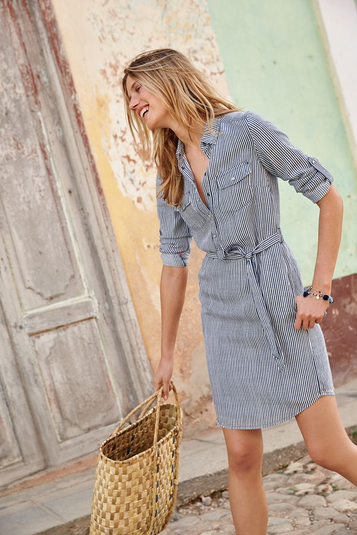 Roll out the red carpet. We're introducing a brand new shirt dress design. Its workwear details (popper fastenings and breast pockets) are given a casual twist with a drapey cut. Shrug on a leather jacket and lace-up flats for an effortlessly chic just-off-for-brunch ensemble.