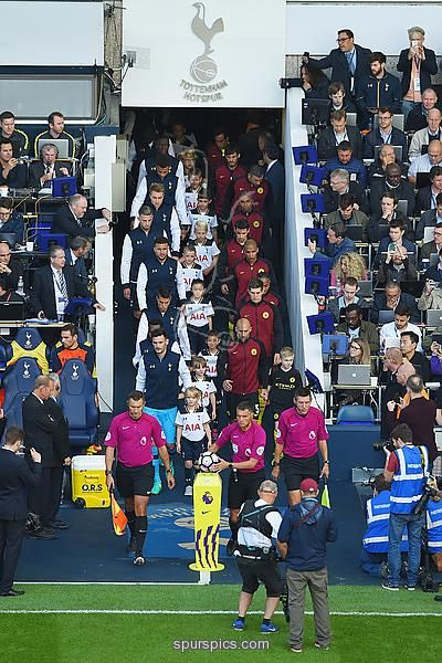LONDON, ENGLAND - OCTOBER 02: The Tottenham Hotspur and Manchester City players walk out before the match during the Premier League match between Tottenham Hotspur and Manchester City at White Hart Lane on October 2, 2016 in London, England