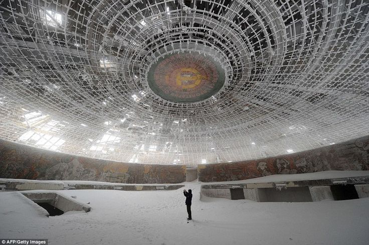 Crumbling away: The oval skeleton of the abandoned House of the Bulgarian Communist Party on Mount Buzludzha in central Bulgaria has lain in a state of neglect for over 20 years.