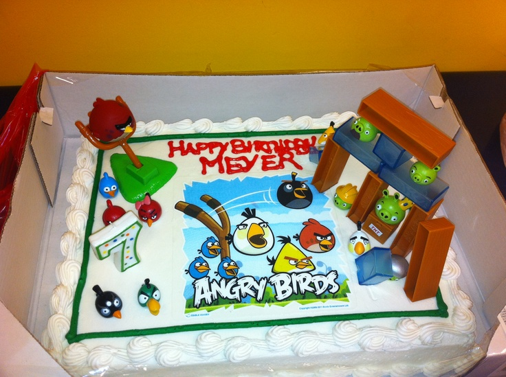 Angry bird Birthday cake. Costco cake with cake sticker and cake toppers from amazon. Wood, ice, slingshot from angry bird board game.