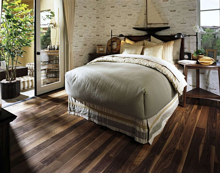 sophisticated single comfortable bed with grey comforter bedding sheet on barn reclaimed dark wood floors in vintage girls bedroom decors - Dark Hardwood Garden Decorating