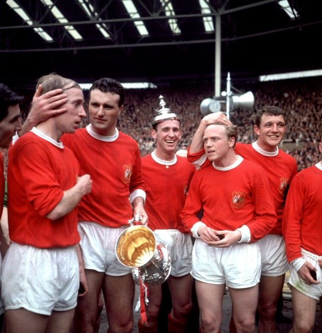 May 25th 1963: FA Cup Final: Manchester United v Leicester City. Manchester United players celebrate with the FA Cup after their 3-1 win: (l-r) Tony Dunne, Bobby Charlton, Noel Cantwell, Pat Crerand, Albert Quixall, David Herd...