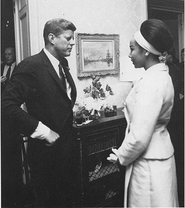 JFK speaks with Diahann Carroll.