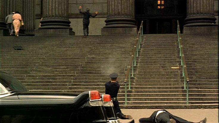 "Richard Conte as Don Emilio Barzini is shot by Corleone enforcer Al Neri (Richard Bright), disguised as a police officer, outside of the New York Supreme Court courthouse at Foley Square during the Baptism Murders scene in ""The Godfather"" (1972)."