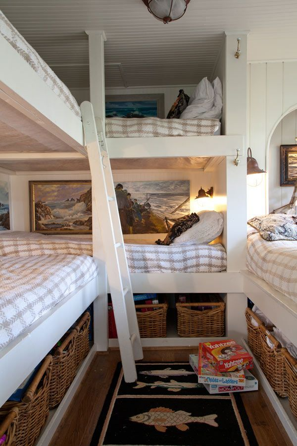 """This room in my cabin with a little more floor space but....""""WOW! Enough room for a family of 6!  2 sets of bunk beds + 1 double bed fit every one into the small sleeping room. The closet was removed to gain room and storage is in baskets that slide under the beds.""""  A good mini guest room...I'm totally doing this when the kids move out."""