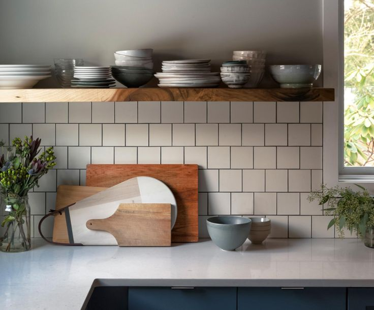 Heath Ceramics tile in M3 Parchment (variation 4) in 4x4 Classic Field makes for a fresh, simple backsplash in this kitchen.  Photo by Jason Varney @varneyphotography. Design by Sara and Jason Varney.