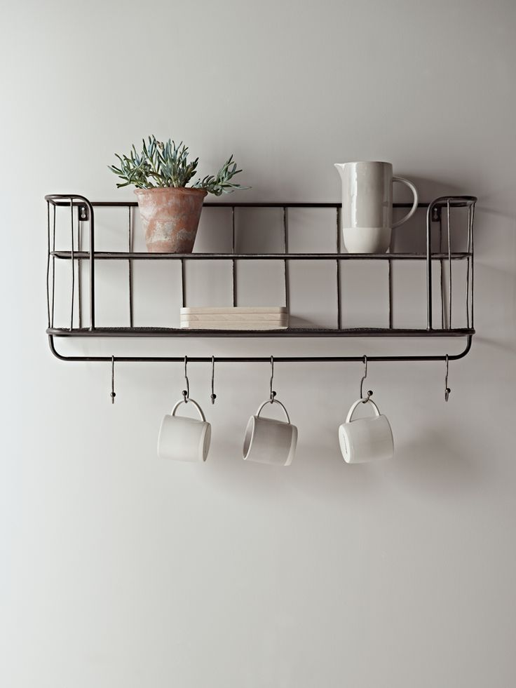 Store your essentials in style with our clever shelf unit. Inspired by the industrial trend, each rustic metal shelf has one solid shelf and one bottom mesh shelf, plus six hooks for hanging, making it ideal for storing your mugs and dinnerware.