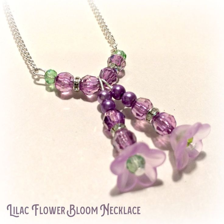 Lilac flower bloom necklace has two pretty pendants comprising lilac and diamante beads and lilac lucite flower head with a tiny glass green bead