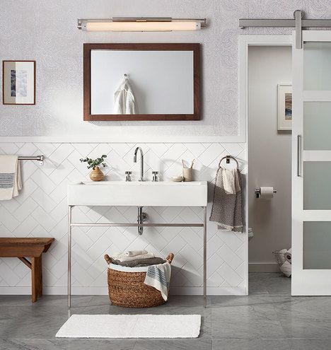 Love the idea of a barn door with glass at the top, but not all the panels/surface. When opened could slide over shelves or a sink on the outside. That could be either great or super frustrating, depending on what needs accessing.