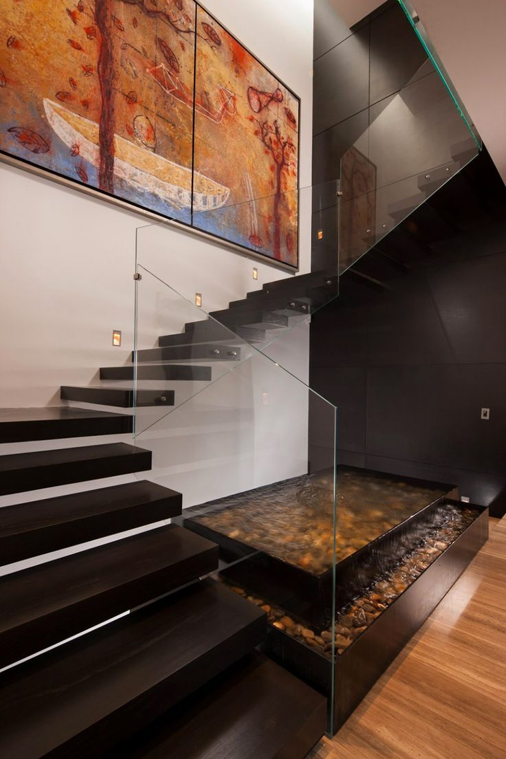 Stunning Darkwood Floating Staircase Design With Glass Balustrade At The CH House Decorated With Koi Pond And Canvas Painting