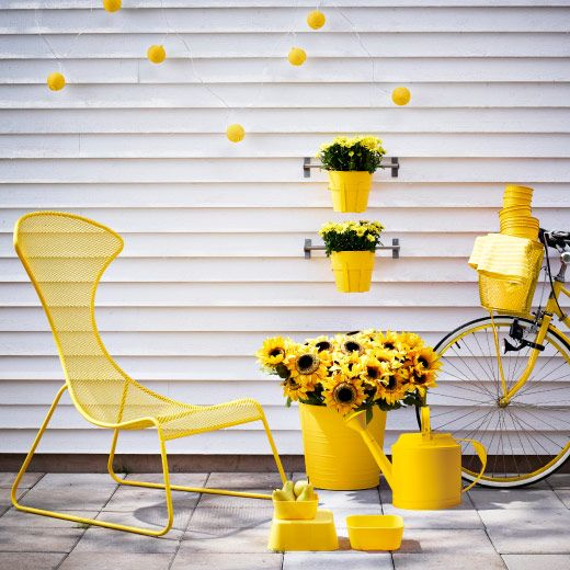 Bright burst of color this summer. IKEA easy chair, plant pots, watering can and serving bowls, all in yellow.