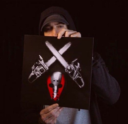 """[Photo] Eminem Reveals """"Shady XV"""" Album Cover- http://getmybuzzup.com/wp-content/uploads/2014/10/shaddycover1.jpg- http://getmybuzzup.com/eminem-reveals-shady-xv-cover/- By Matt Tompkins See that lovely square that Eminem is holding up? That's your album cover for the upcoming Shady Records compilation project, Shady XV. The project's title is in reference to the 15th Anniversary (wow, I'm old) of Shady Records. Expect the LP to drop on...- #Eminem"""