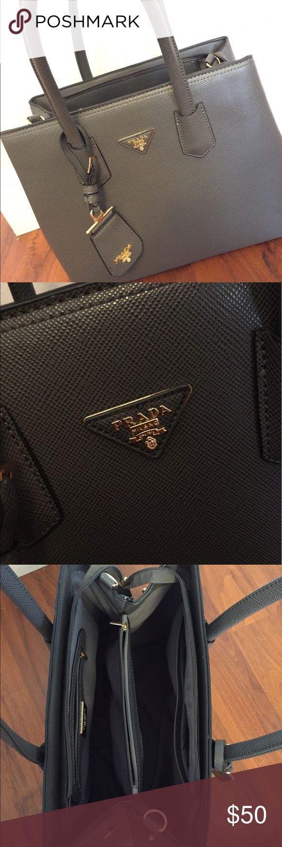 Beautiful Prada Purse for sale Gray Prada Purse for sale (dont ask the obvious) with a lot of space usea once Bags Clutches & Wristlets