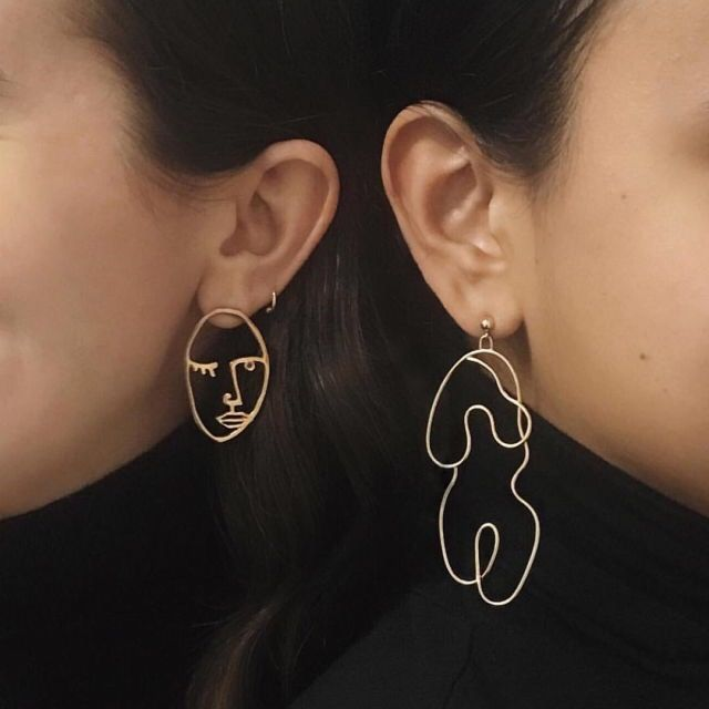Paola Vilas earring on the left, Knobbly Studio earring on the right