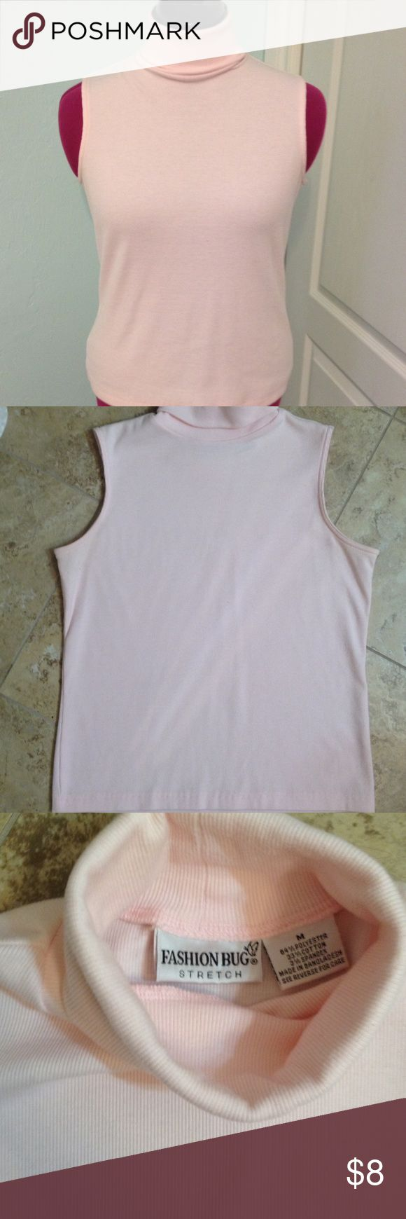 Pink Sleeveless Turtleneck This is a light pink sleeveless turtleneck top, it's a Size M. In great condition. Fashion Bug Tops Tank Tops
