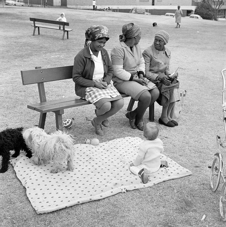 David Goldblatt - Baby with childminders and dogs in the Alexandra Street Park, Hillbrow, Johannesburg, 1972