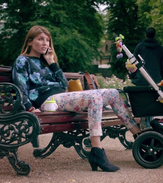 Sharon Horgan on Catastrophe: Season 2, episode 2: White and pink floral pants, blue and black floral sweater, black ankle booties