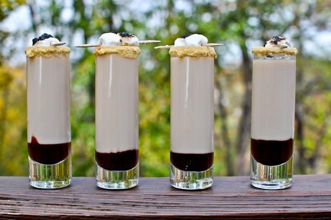 Smores Shooters 1/2 ounce marshmallow vodka (or vanilla, whipped cream or cake flavored vodka) 1/2 ounce Godiva chocolate liqueur 1/4 ounce Bailey's Irish Cream liqueur 3/4 ounce cream/half and half chocolate syrup or hot fudge graham cracker crumbs (or seek alternative sweet, plain biscuit) vanilla frosting for glass rimming mini marshmallows