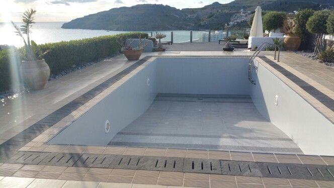 Painted in soft greys at the side, contemporary grey tiles at the bottom and new granite grill surround.