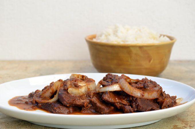tender beef slices simmered in a lemon-soy sauce mixture...topped with lots of onions...Bistek Tagalog (Filipino Beef Steak) recipe here http://www.kawalingpinoy.com/2013/01/bistek-filipino-beefsteak/