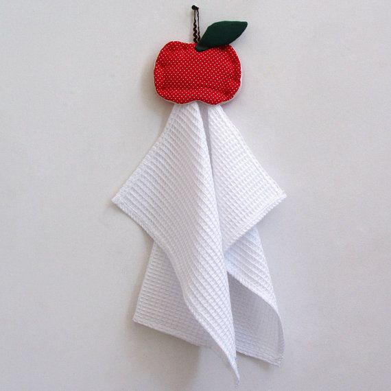 Waffle pique kitchen towel hanging from an apple