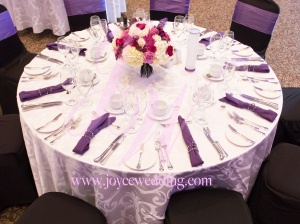 #Middle sized #centerpiece contains #purple and #pink #roses, #white #hydrangeas, #chrysanthemums, #tulips and #sunflowers. The #centerpiece fit perfectly with the #wedding's #purple/black #theme #colour and gives the table #decoration guests will never forget.