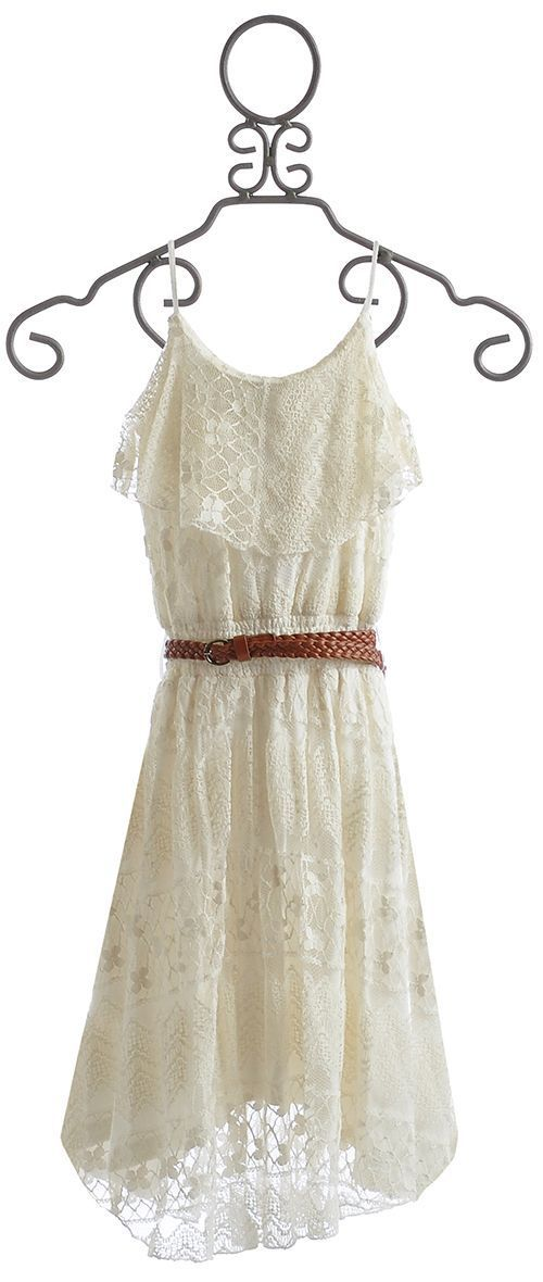 White lace dress with brown leather belt