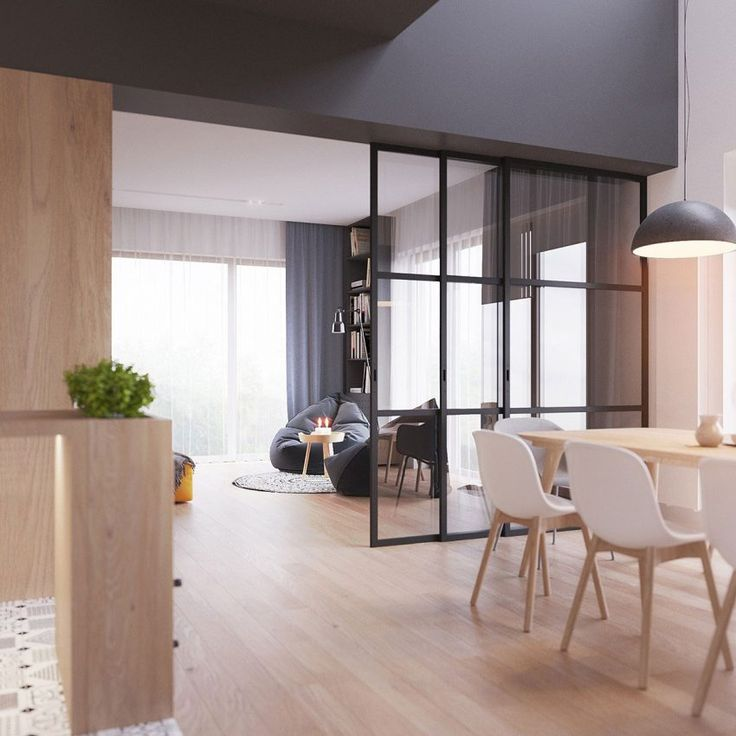 """Scandinavian Inspiration by ZROBYM Architects (7) Interior """"window"""" wall gives nice separation between Living and dining rooms without any loss of sight lines of light."""