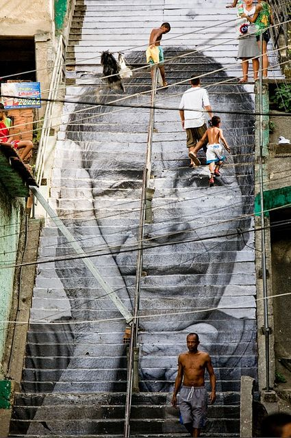 """Women Are Heroes. Photographic art on stairs at the entrance of Rio's Favela """"Morro da Providencia"""". August 2008 (www.jr-art.net)."""