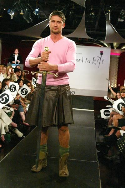 """Scotland native Gerard Butler models a leather kilt at """"Dressed to Kilt: A Scottish Evening of Fashion and Fun"""" at Copacabana in New York City on April 6, 2005."""