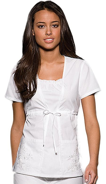 Get an elegant look with this solid scrub top from Cherokee Uniforms. It features a shaped front seams with a center front inset that provides this top its two-piece look.