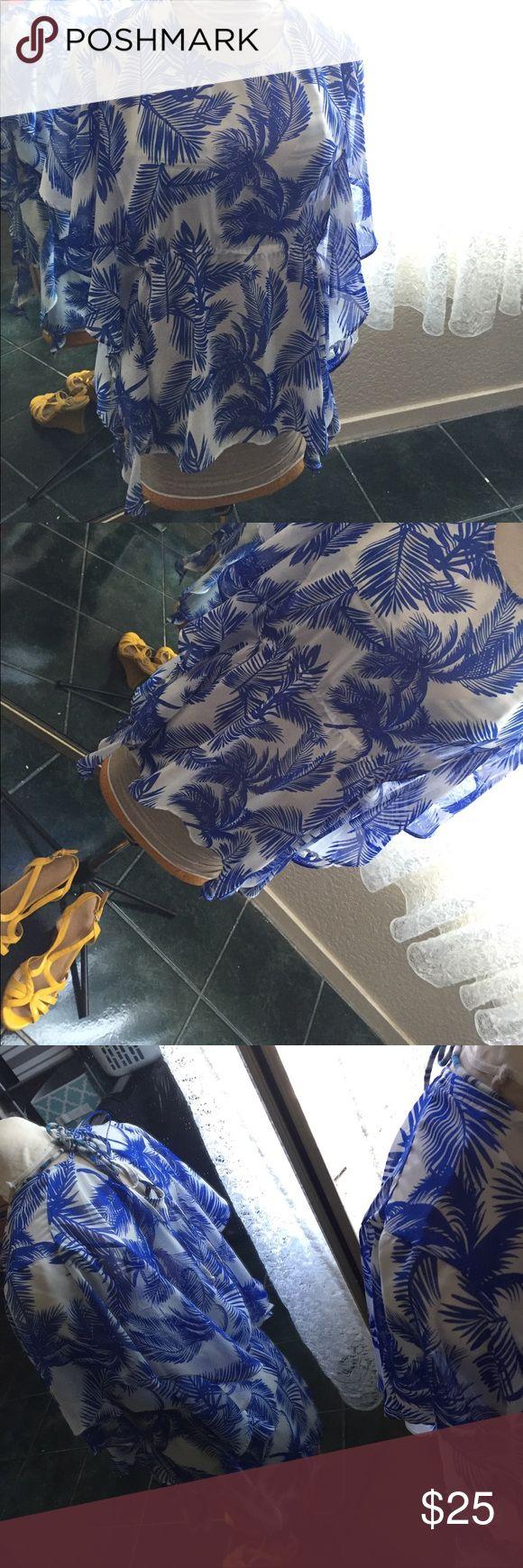 Sofia Vergara swim cover up in royal blue & white Never worn swimsuit cover up in royal blue and white. Design is palm trees. No damage. No smell. Sofía Vergara Swim Coverups