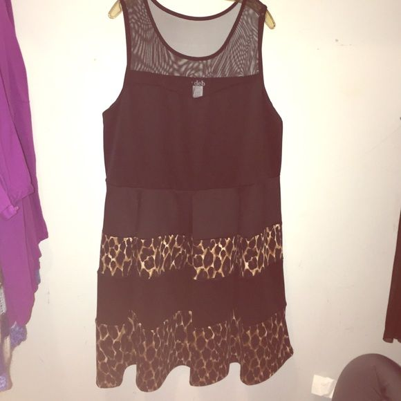 Cheetah Print Dress NWOT‼️ bought this for a wedding, and never ended up going and have never worn it since! A mesh material on the upper shoulder part of the dress & a cheetah print and black fabric on the bottom. Nice & flowy. True to size!! SO cute :) Deb Dresses
