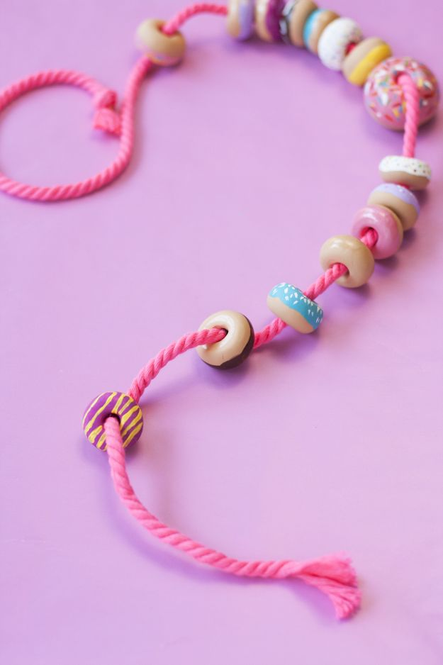 String together a necklace using delicious-looking doughnut beads.