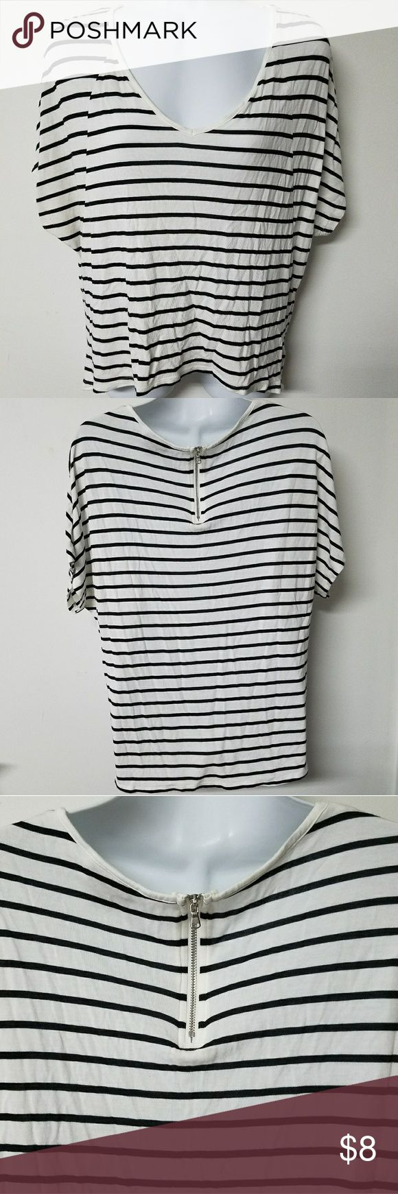 Mossimo black and white juniors small shirt GUC Up for sale is a preowned Mossimo by Target juniors small shirt. It is an off white color with black stripes and a zipper in back. It does have a small stain on the inside of the shirt near the zipper, which is seen in the last picture. It is also faint, so not too noticeable. It is in great condition, with lots of wear left.   Thanks for looking and feel free to make an offer! Ask any questions you may have. 💗 Mossimo Supply Co. Tops