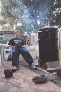 meat smoker - no idea what that guy is doing but I like the design of the smokehouse