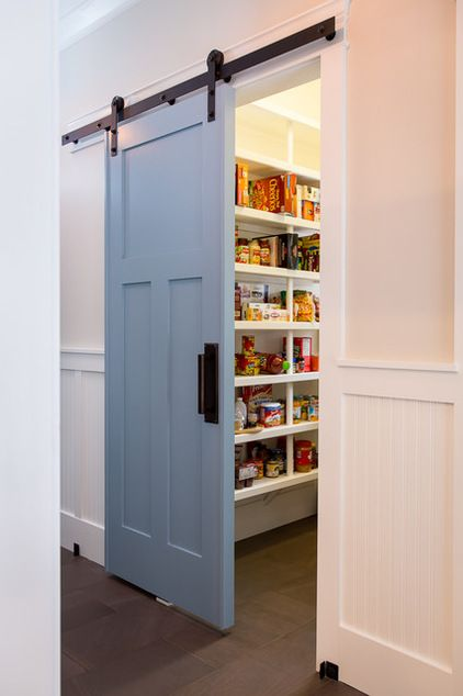 Love the idea of a barn door for a pantry..Beach Style Kitchen by Marty Rhein, CKD, CBD - BAC Design Group