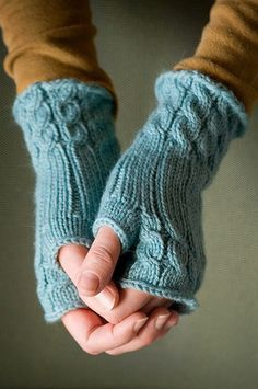 Blue fingerless gloves - looks like the fetching pattern http://knitty.com/ISSUEsummer06/PATTfetching.html