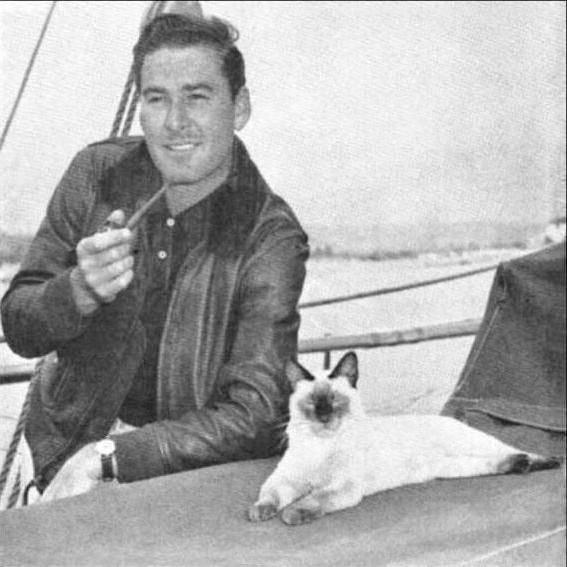 Errol with Bes Mudi, his Siamese cat, and Zaca's mascot. The Siamese was given to Errol by makeup man, Ward Hamilton. , Bes Mudi's Dam was Mei Ling and her Dam Ah Fui. Mei Ling's sire was Brant's Prince Chan who came out of the Double International champion, Si Mingo.