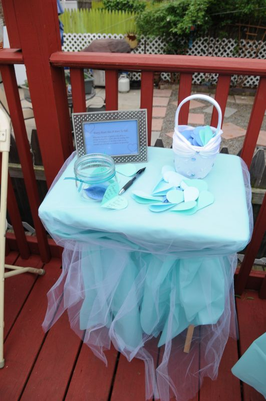 Alternatives to traditional linens :  Plastic table cloth with tulle overlay