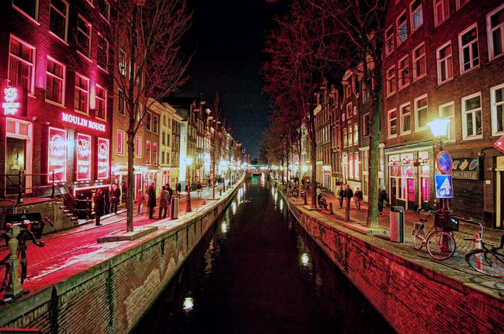 De Wallen or De Walletjes is the largest and best known red-light district in Amsterdam and consists of a network of alleys containing approximately three hundred one-room cabins rented by prostitutes http://vacationandtripplanning.blogspot.com/2015/11/7-best-places-to-visit-in-amsterdam.html