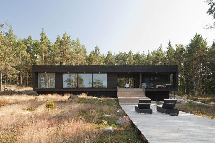 entry-summer-villa-vi-slices-through-home-to-lakeside-dock-13-walkway.jpg