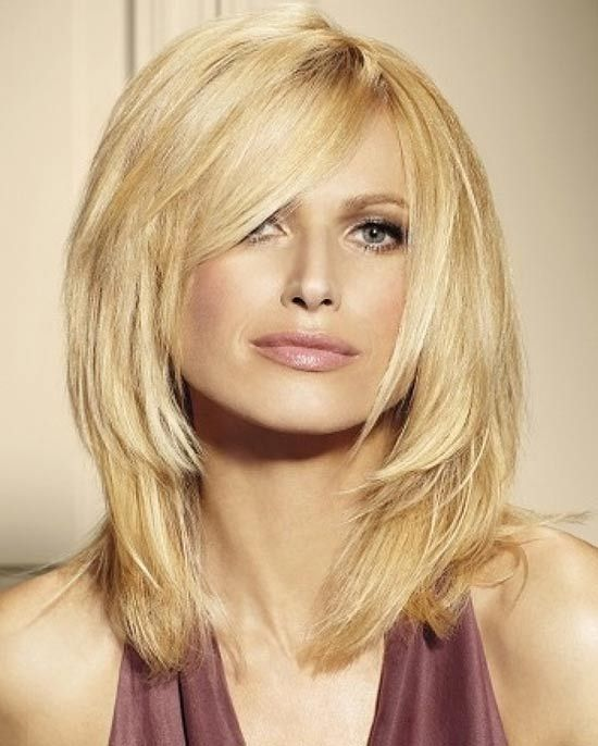 Choppy Medium Side Bangs with layered shoulder length hairstyle