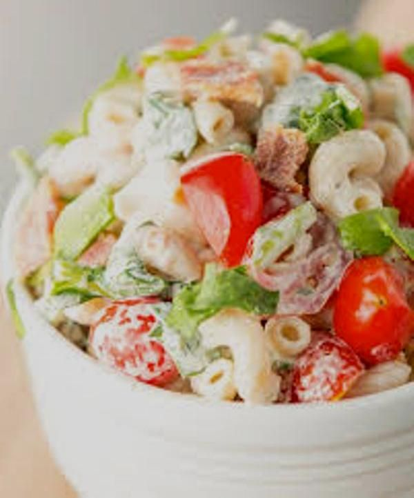 Ingredients:  1/2 cup mayonnaise  3 tablespoons chili sauce  2 tablespoons lemon juice  1 teaspoon sugar  3 cups elbow macaroni, cooked  1/2 cup tomato, seeded and chopped  2 tablespoons green onions, chopped  3 cups lettuce, shredded  4 slices cooked bacon, crumbled    Directions:  1. In a large bowl,