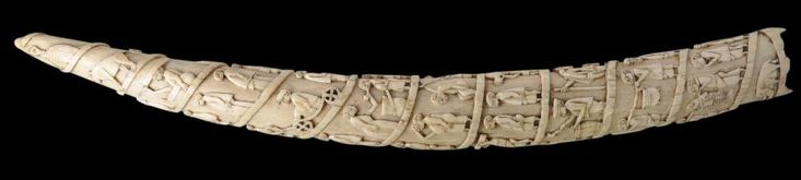 Loango Ivory Elephant's Tusk carved with Scenes of Indentured African Porters Congo or Angola 1830-1890 length: 56cm This particularly wel...
