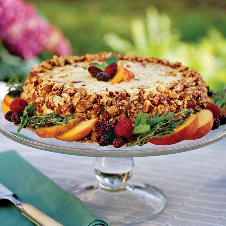 Cha-Cha Chicken Salad   Impress your guests with this creamy chicken salad that's pressed into a mold and inverted onto a cake stand. Press chopped almonds into the side and surround the chicken salad with fresh herbs and fruit for an over-the-top presentation.