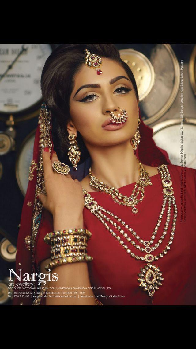 Indian bride wearing bridal lehenga and jewelry.