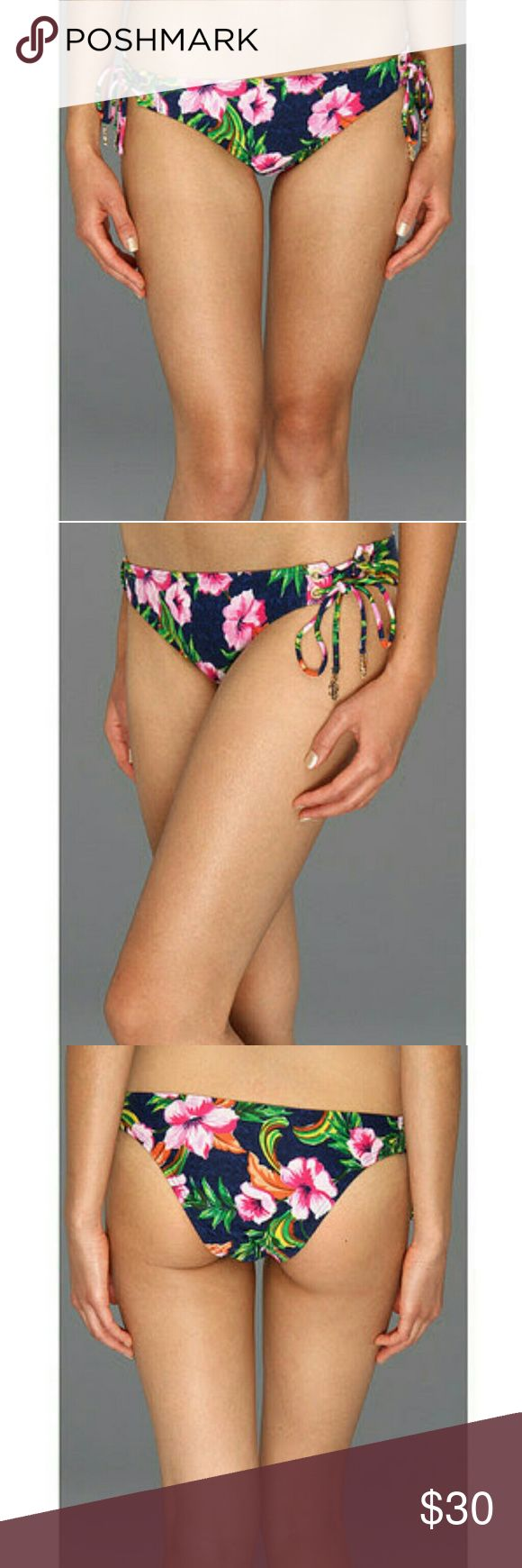 Juicy Couture Lace Up Flirt Bottoms Large/XL Swimsuit Separates Bottom Only Whether you're at faraway beaches or a backyard pool party, these sultry Juicy Couture bottoms are sure to be a crowd pleaser. Allover exotic floral print/ low rise with a cheeky coverage/ lace up ties at hips flaunt metallic hardware / lined/ 85% Meryl nylon 15% spandex/ Lining: 76% Polyester 24% spandex/ hand wash cold / Style #Y37084 Juicy Couture Swim Bikinis